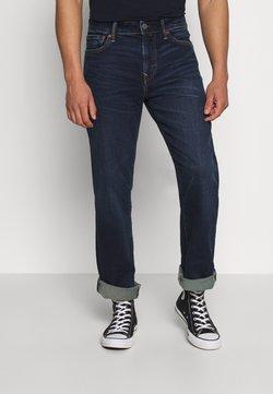 American Eagle - RIGID ORIGINAL - Jeans Bootcut - dark indigo wash