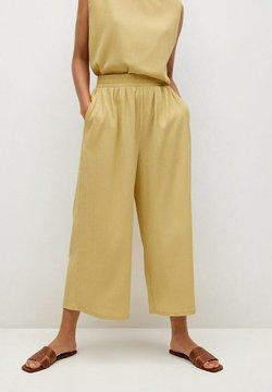 Mango - Spodnie materiałowe - mustard