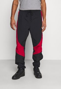 Jordan - Jogginghose - black/gym red