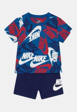 Nike Sportswear - FUTURA SET - Pantalon de survêtement - blue void