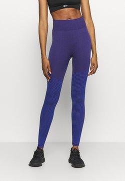Reebok - SEASONAL SEAMLESS - Tights - purple