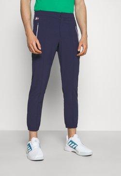 Lacoste Sport - OLYMP PANT - Jogginghose - navy blue/white