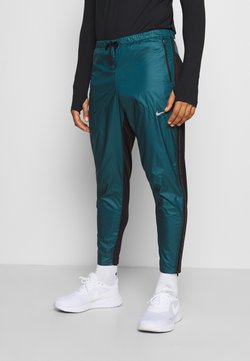Nike Performance - SHIELD - Pantalones deportivos - dark teal green/black/silver
