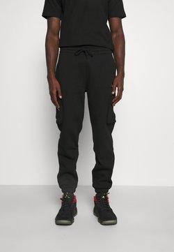 New Era - CARGO - Jogginghose - black