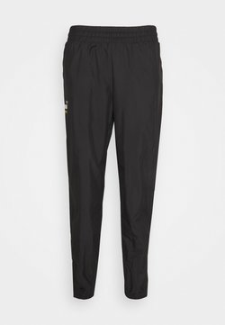 Puma - ICONIC KING TRACK PANTS - Jogginghose - puma black
