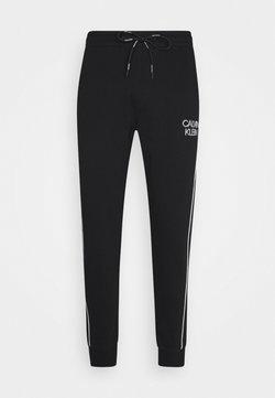 Calvin Klein - TWO TONE LOGO PANT - Jogginghose - black