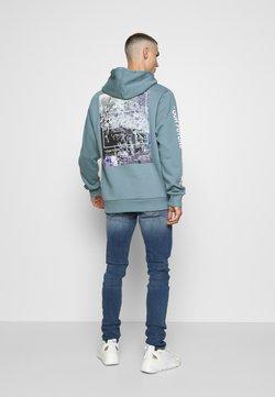Tiger of Sweden Jeans - SLIM - Jeans Skinny Fit - medium blue