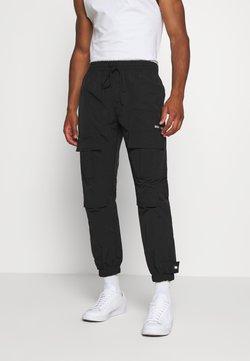 WRSTBHVR - TROUSER HYDRO UNISEX - Cargo trousers - black