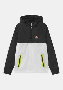 Ellesse - STERLINIO UNISEX - Training jacket - black/white
