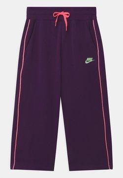 Nike Sportswear - GLOW IN THE DARK  - Träningsbyxor - grand purple/vapor green/sunset pulse