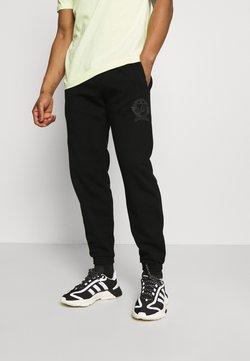 adidas Originals - COLLEGIATE CREST UNISEX - Jogginghose - black