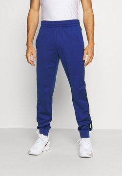 Lacoste Sport - TENNIS PANT BLOCK - Jogginghose - cosmic/navy blue/white