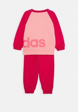 adidas Performance - ESSENTIALS SPORTS SET UNISEX - Trainingspak - glow pink/power pink/signal pink