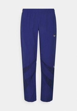 adidas Originals - ANIMAL - Jogginghose - victory blue/black