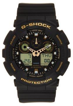G-SHOCK - Montre à affichage digital - schwarz/gold-coloured