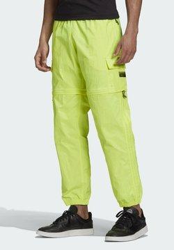adidas Originals - R.Y.V. UTILITY 2-IN-1 TRACKSUIT BOTTOMS - Jogginghose - yellow