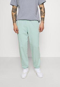 adidas Originals - PREMIUM UNISEX - Jogginghose - hazy green