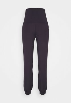 Curare Yogawear - LONG PANTS ROLL DOWN - Jogginghose - dark aubergine