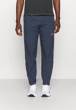 Nike Performance - RUN STRIPE PANT - Spodnie treningowe - thunder blue/dark obsidian/silver