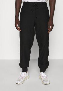 Carhartt WIP - AMERICAN SCRIPT PANT - Jogginghose - black