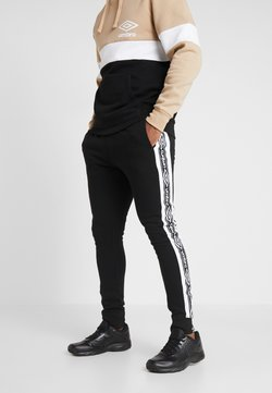 Umbro - TAPED FLEECE JOGGER - Jogginghose - black/brilliant white