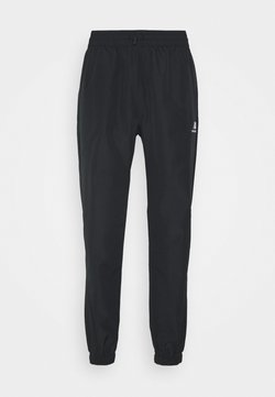 New Balance - ATHLETICS WIND PANT - Jogginghose - black