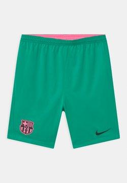 Nike Performance - FC BARCELONA UNISEX - Pantalón corto de deporte - new green/black