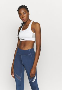Puma - PAMELA  REIF X PUMA  COLLECTION LAYER SPORT CROP  - Sport-BH mit mittlerer Stützkraft - star white
