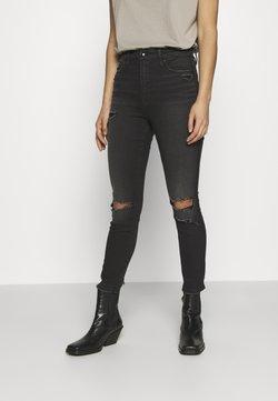 Good American - CURVE CROP BACK CHEWED HEM - Jeans Skinny Fit - black