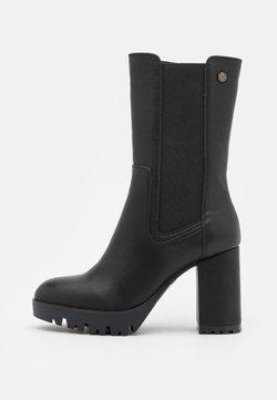 XTI - High heeled boots - black