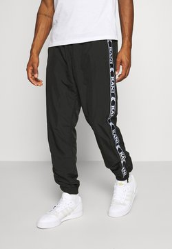 Karl Kani - TAPE TRACKPANTS - Jogginghose - black