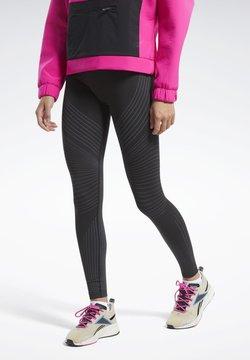 Reebok - SEAMLESS LEGGINGS - Tights - black