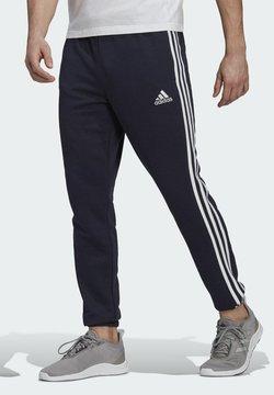 adidas Performance - ESSENTIALS FRENCH TERRY TAPERED 3-STRIPES JOGGERS - Spodnie treningowe - blue