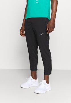 Nike Performance - RUN PANT - Jogginghose - black/silver