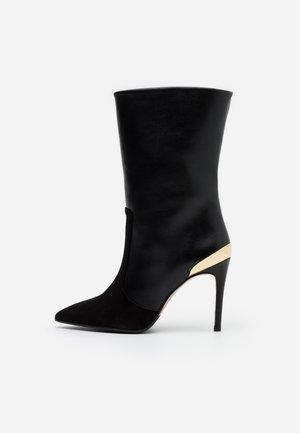 Oxitaly Brede schacht laarzen online kopen | ZALANDO