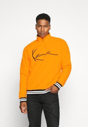 Kjøp Karl Kani Skjorter til herre på nett | FASHIOLA.no