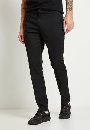 Dickies Chinos | Chino bukser til herre, dame og barn hos