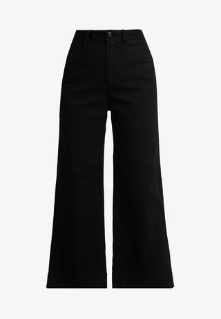 WIDE LEG SOLID - Flared Jeans - true black